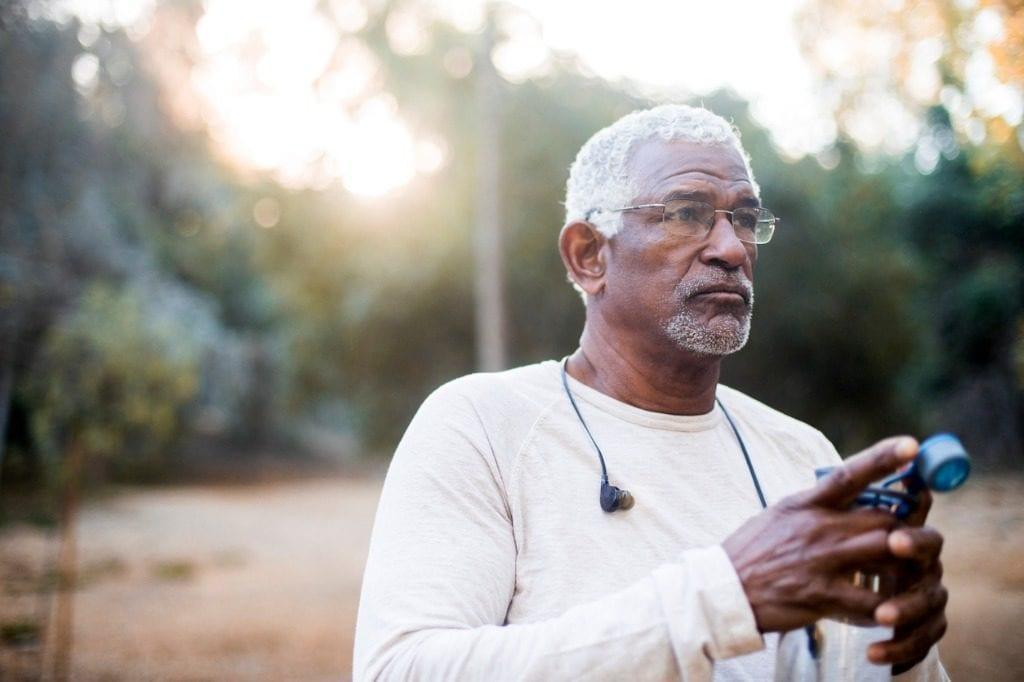 senior man using media device