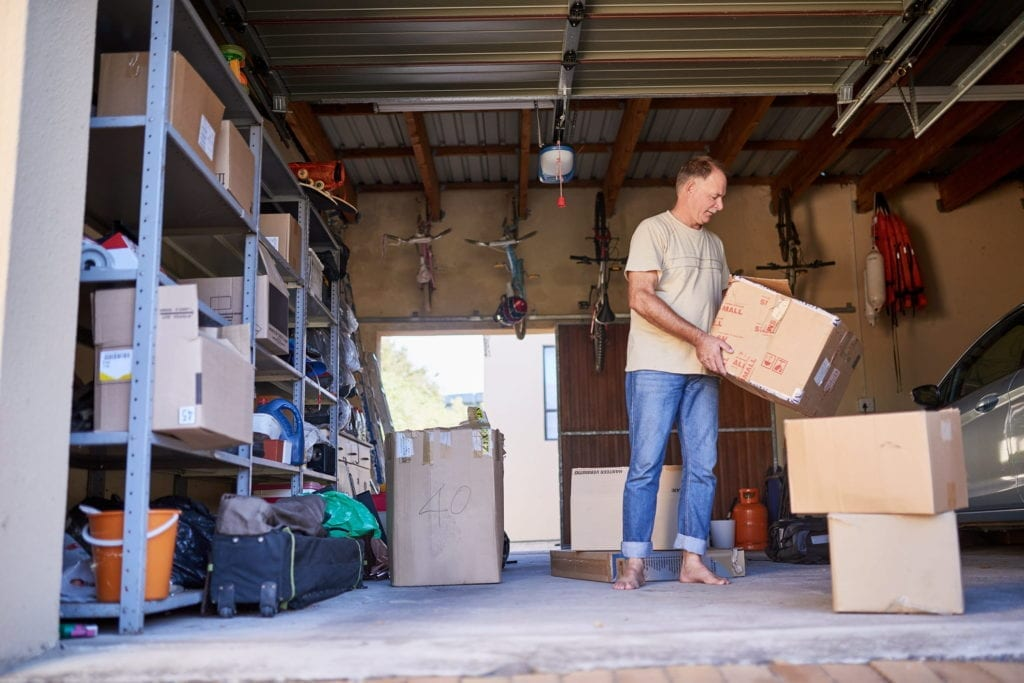 a man safely storing items in garage