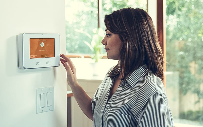 photo of woman using Vivint Smart Home Security panel