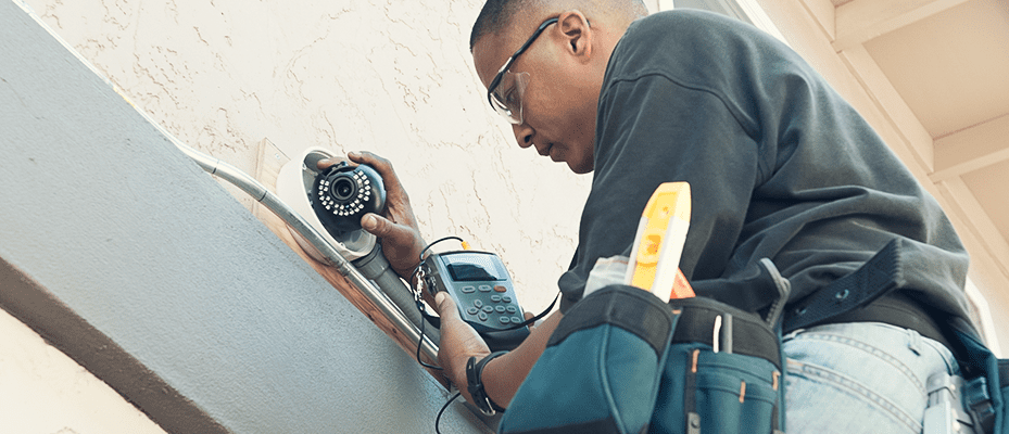 technician install a home security camera