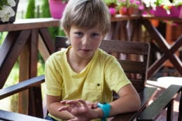 Boy with smart watch on a terrace